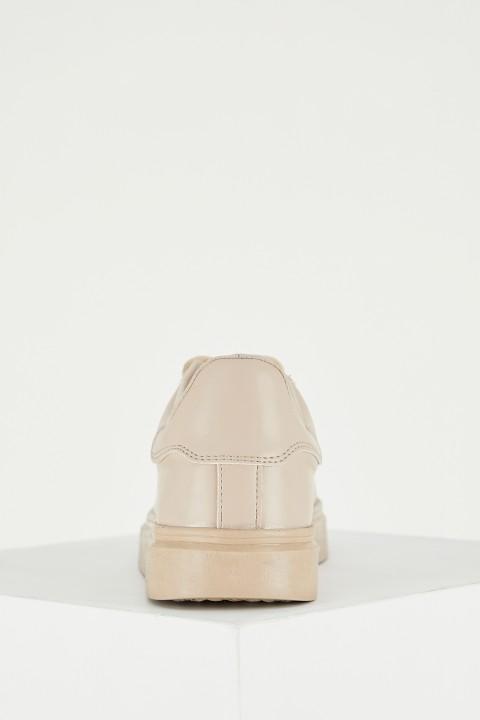 woman-beige-shoes-36-8946345.jpeg