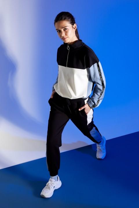 woman-black-knitted-trousers-l-8301319.jpeg