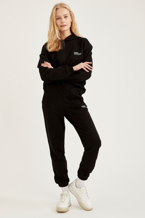 woman-knitted-trousers-black-2642289.jpeg