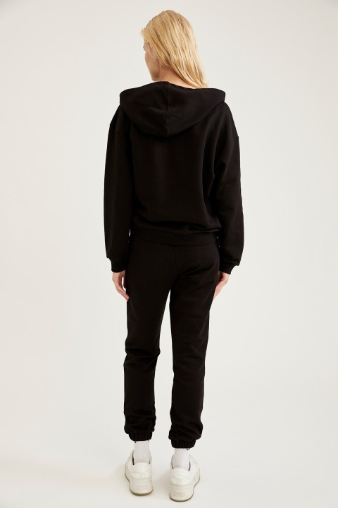 woman-knitted-trousers-black-4539076.jpeg