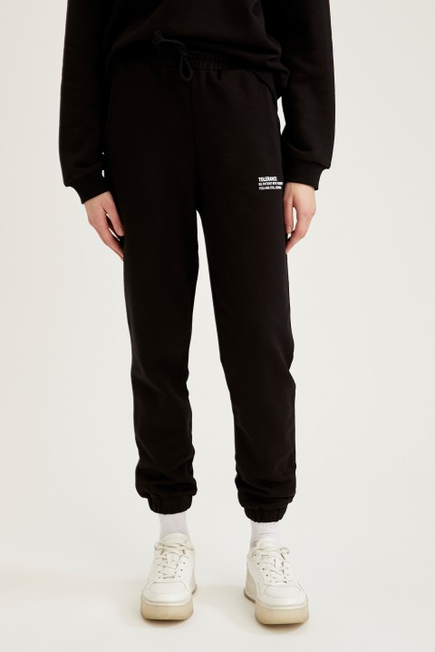 woman-knitted-trousers-black-6955867.jpeg