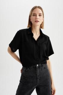 woman-black-short-sleeve-shirt-xl-6643029.jpeg