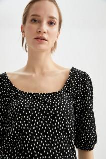 woman-black-short-sleeve-t-shirt-l-6-2516833.jpeg